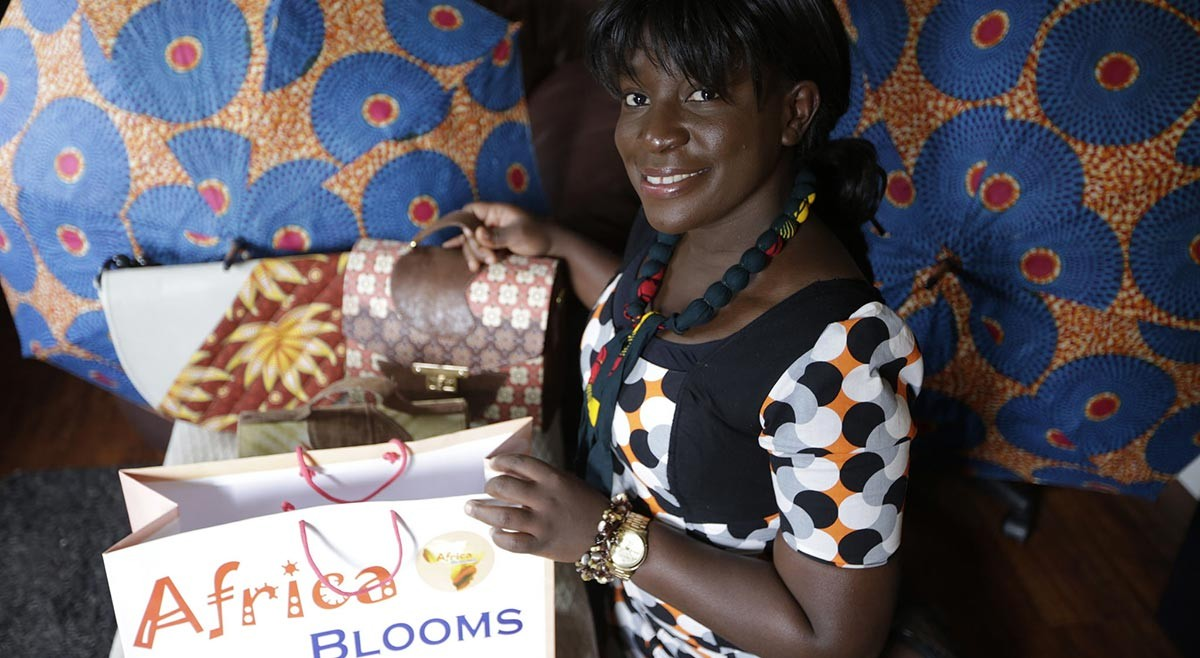 Image of Blooming hold her products from Africa Blooms