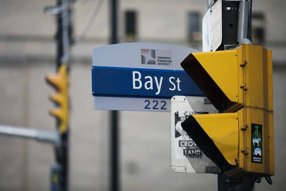 "closeup image of street sign ""Bay Street"" in downtown Toronto"