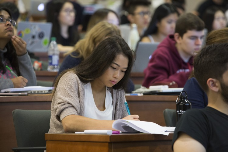 Image of Thao Atkinson taking notes in class