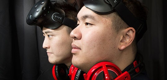 Image of 2 men wearing VR headsets on the foreheads