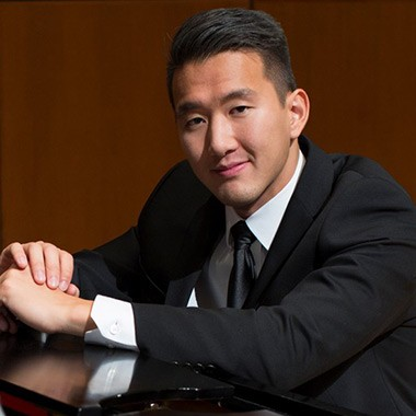 Profile image of B+MM alumni student, Terry Chen leaning on a piano