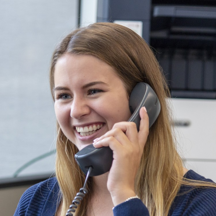 Receptionist answers student inquiries on the telephone