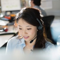 Image of woman with a headset talking