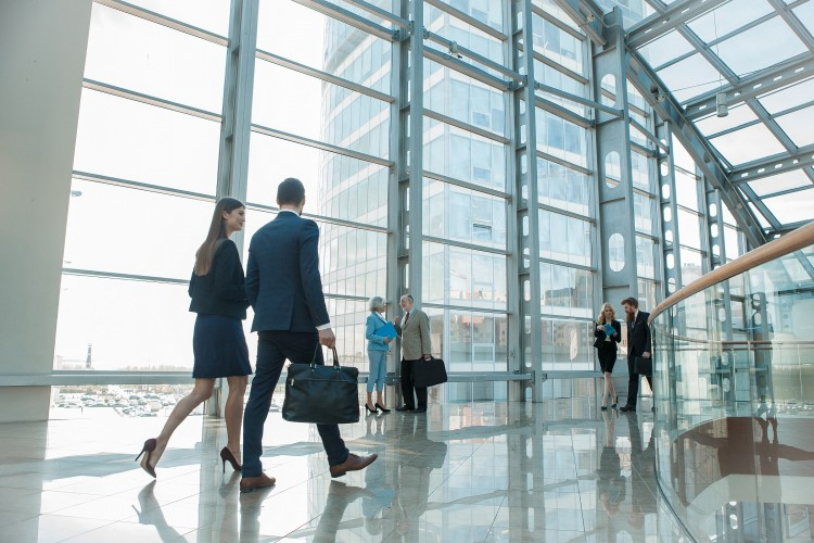 Business people walking in a modern building