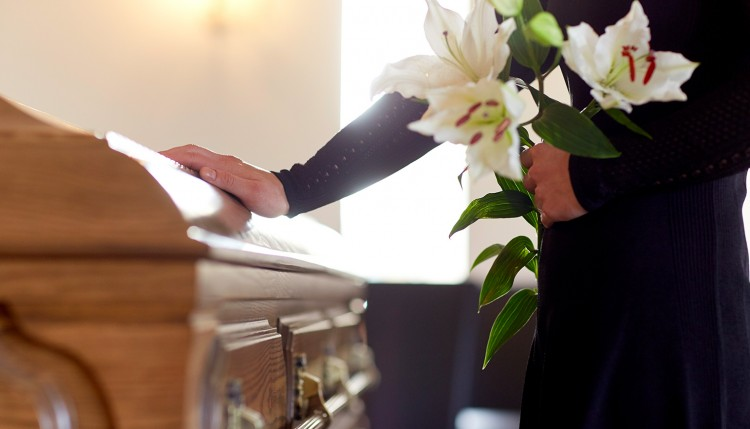 Image of a person at a funeral.