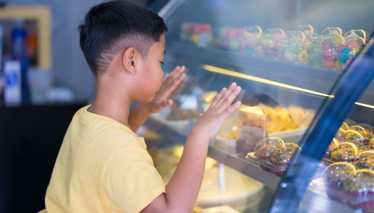 Child looking at baked goods.