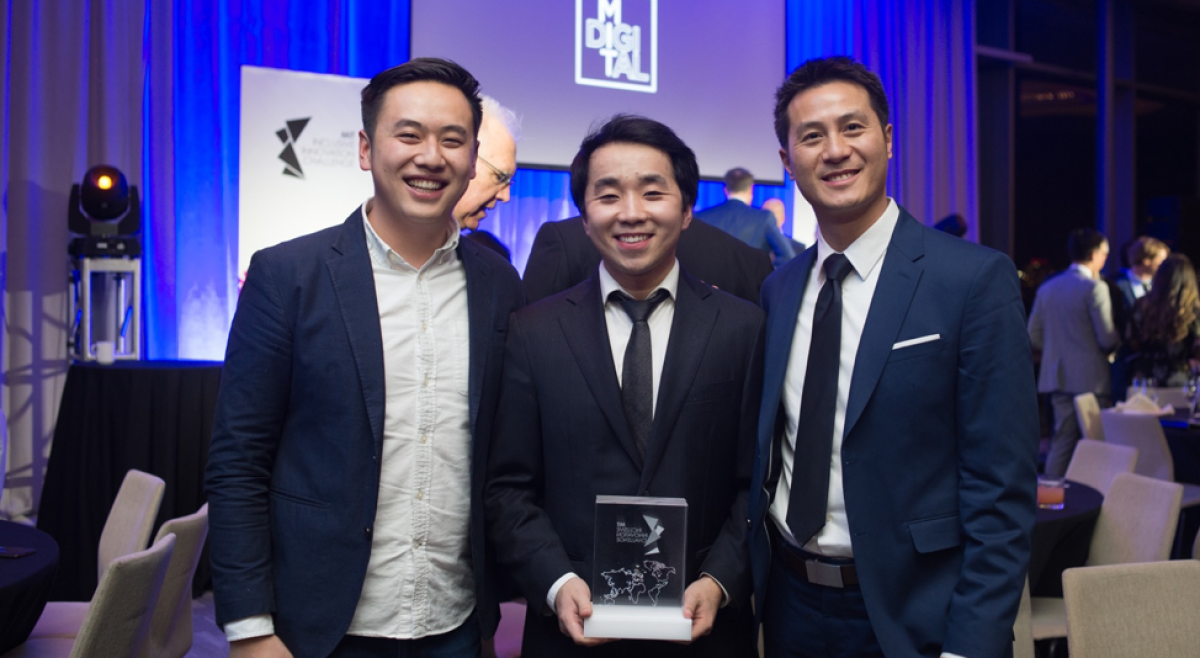 JobGet co-founders Billy Lan (left), Tony Liu (centre) and Peter Lee (right) accept the Global Grand Prize at the awards ceremony for the 2019 MIT Inclusive Innovation Challenge.